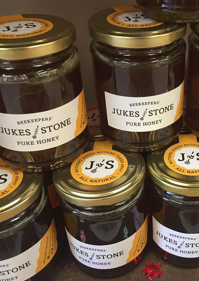 Jukes and Stone honey jars stacked on a shelf