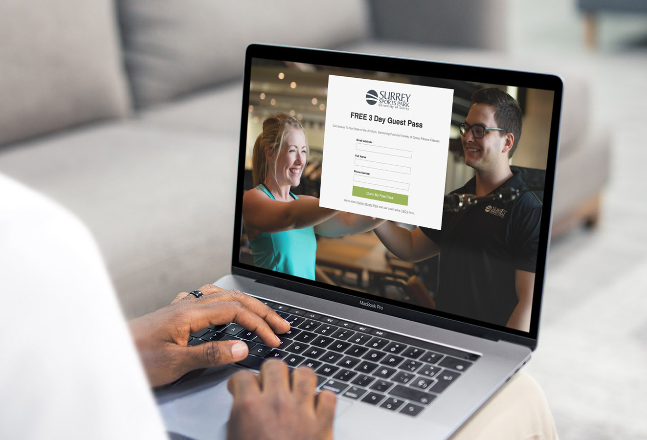 Person viewing free gym pass landing page to opt in on their laptop